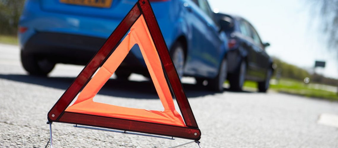 28154924 - warning triangle by two cars involved in accident
